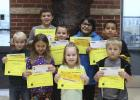 October Elementary  Students of the Month Pictured in front:  Trevor Bjerke, Isabelle Krog, Maci Syverson, Edward Nybo. Pictured in back: Broden Benson, Dawson Gazelka, Taivion May, Drayden Cobenais-Neadeau.