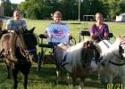 The Hearts For Carts Pony Cart Club will be performing at the Rhythm and Ride Show at the Clearwater County Fair.  Pictured are Nadine Klasse and her Grandson Colton, Peggy Arlaud and Karen Stormo.  They will be driving to a Beach Boys song, so come and see their horses dressed like surfers!