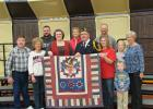 Receiving a Quilt of Valor during the Veteran's Day program at Win-E-Mac School was Allen Jenson. Allen is pictured here with his family that was in attendance.