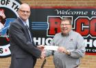 Garden Valley Education Foundation Director Freitag (right) is shown presenting a $5,000 Education Foundation grant to Red Lake County Central High School Principal Randall Pederson.