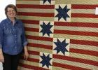 Displaying her beautiful Quilts of Valor quilt, that will be given to a local serviceman or woman is Kathryn Carver. The quilt was quilted by Colette Fish.