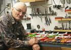 Tom Hemphill, well-known retired Fosston teacher, is shown with a selection of his hand-carved fish decoys.