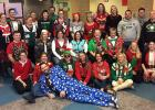 Pictured is the staff that participated by wearing an ugly sweater.