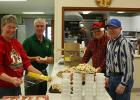 The Grygla/Gatzke Lion's Club held their annual Christmas Eve dinner at the Community Center in town last Thursday. 15 community members were served, along with 21 Lion's members. In addition to those numbers, over 40 free meals were delivered to homes around the area that afternoon. Pictured are Lion members Laurie and Gary Polansky, Lon Englund and Wayne Warne helping prepare the to-go boxes.