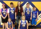 "Grygla Elementary Intramural Basketball has wrapped up for the year. 4-6 graders have been playing every Friday from 1:30-3:30pm. The ""Eagles"" placed first; they were coached by Shantel Verbout. In the front is Chelsie Nelson and Russ Rian. Back, L-R: Emily Carlson, Tucker Verbout, Shantel Verbout, Walter Jones, Lewis Jones."