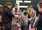 Iron Chargers working on one of their robots at a recent competition. Photo courtesy of Grygla School