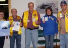 The following Lion's members are pictured with their patches at the Zone 7 meeting in Wannaska: Lion Mildred Klamar, representing the Grygla Lions; Lion Bill Wagner, representing the Greenbush/Badger Lions; Lion Richard Arntzen, representing the Warroad Lions; Lion Colleen Hoffman, representing Goodridge Lions; and Lion Roland Anderson of the Wannaska Lions.