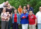 Barb, center, is pictured with her mom on the occasion of Mom's 80th birthday party. Barb's daughter, Brianna, is on the left holding granddaughter, Zoey. To the right of Barb is her grandson, Chase, and son, Jedediah. In the back are grandchildren Karissa, Malayna, Sherman, Adria and daughter-in-law, Nicole.